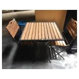 Metal folding patio table with 2 folding chairs -