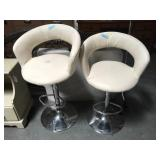 Pair of modern white and chrome bar stools -