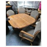 Wood dining table with 4 rolling chairs