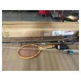 Lot of fishing poles, tennis racquet and