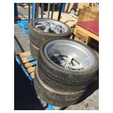 Set of 4 305/30 ZR22 105Y tires on rims