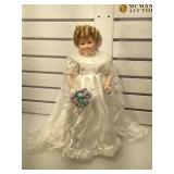 The Danbury Mint porcelain Shirley Temple doll,