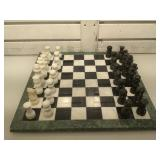 Carved stone chess set