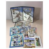 Stamp album of fighter planes & approx. $50 fave