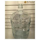 Large glass jug, measures 19 inches tall