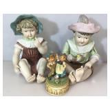 2 porcelain Statues & music box, figures sit