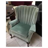 Green ornate arm chair w/carved wooden legs,