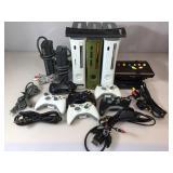 3 Xbox 360 consoles, Wii U console, controllers &