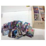 Box of sports cards in sleeves and hard cases