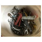 Bucket of assorted wrenches and more