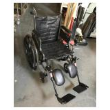 Tracer EX2 wheelchair with footrests and tank