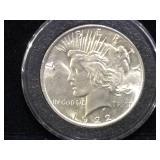 1922 Peace Silver Dollar in case