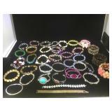 Batch of 37 costume jewelry bracelets.