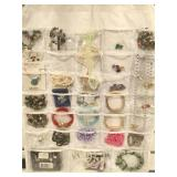 Hanging jewelry bag filled with a assortment of