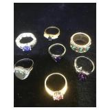 Assortment of 7 costume jewelry rings.