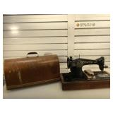 Antique singer sewing machine in carrying case