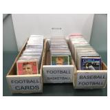 3 boxes of sports cards in sleeves with stars