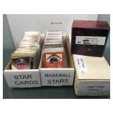 3 boxes of sports cards some in sleeves with