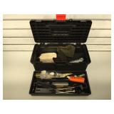 Gun cleaning supplies in plastic toolbox