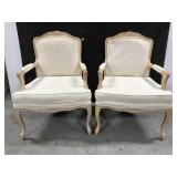 Pair of Harris Marcus ornate wood arm chairs