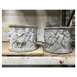 Pair of old concrete cherub planters