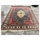 Wool pile area rug