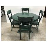 Green clawfoot dining table w/ four chairs