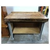 Butcher block table on industrial metal base