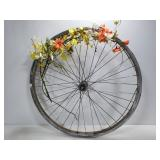 Floral decorated bicycle wheel art