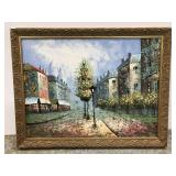 Tree lined cityscape painting in ornate frame