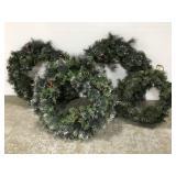 Four lighted Christmas holiday wreaths