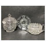 Cut glass petite plate, lidded jar and sugar bowl