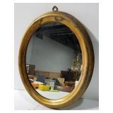 Small oval brass-look mirror