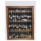Souvenir spoons in wood display case