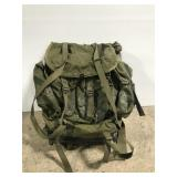 Metal framed green military backpack