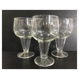 Trio of open stem wine glasses