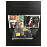 Three assorted CDs unopened