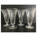 Set of four etched footed glasses