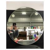 Round mirror with flower accents