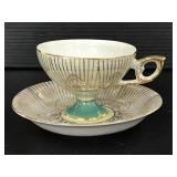 Iridescent flower teacup and saucer