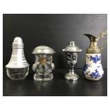 Four vintage salt and pepper shakers