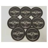 Eight black NHL official coasters