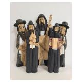 Carved wood men playing instruments figures