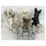 Seven ceramic doggie statuettes