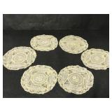 Six vintage round doilies