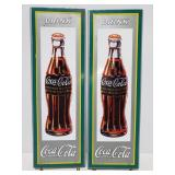 Two metal Coca Cola reproduction signs