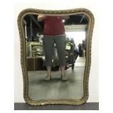 Vintage wall mirror with braided design