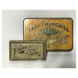 Two small vintage tins
