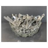 Lot of assorted vintage silverware in glass bowl