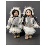 Pair of porcelain Eskimo girl dolls